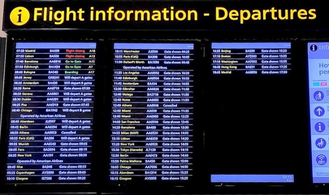Departure board at London Heathrow Airport Terminal 5