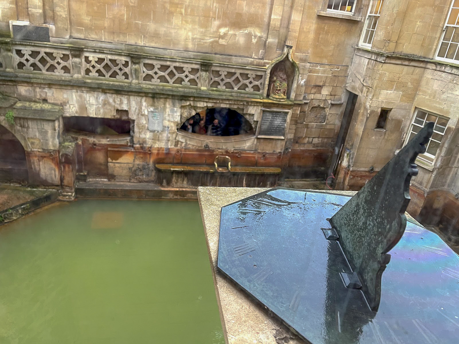 a sundial overlooking the Sacred Pool from The Pump Room Bath