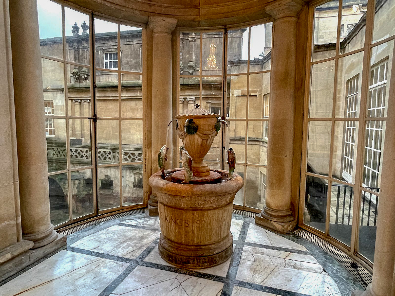 The marble mineral fountain in a recess in The Pump Room Bath