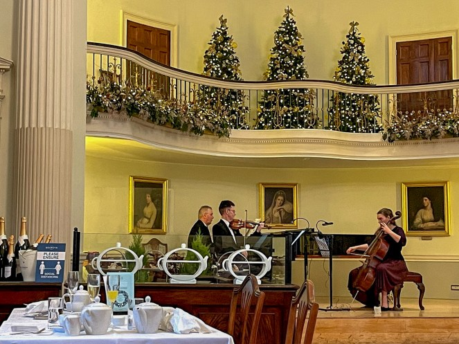 The Pump Room Trio - a pianist, cellist and a violin player in the Music Gallery in The Pump Room Bath