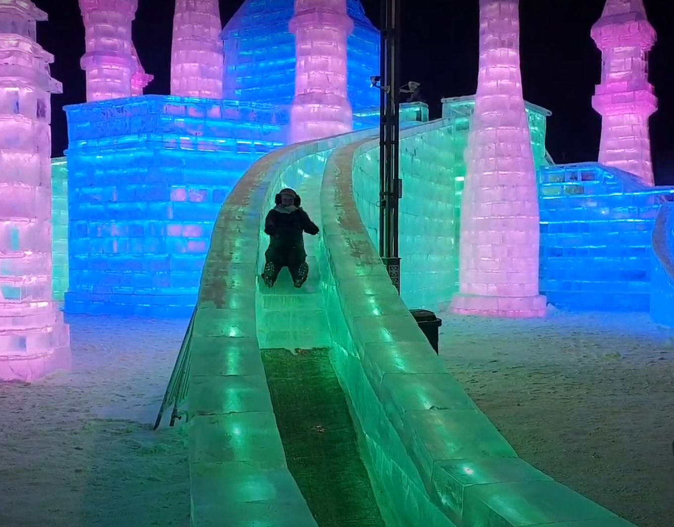 Rosie on a green ice slide at Harbin Ice and Snow World