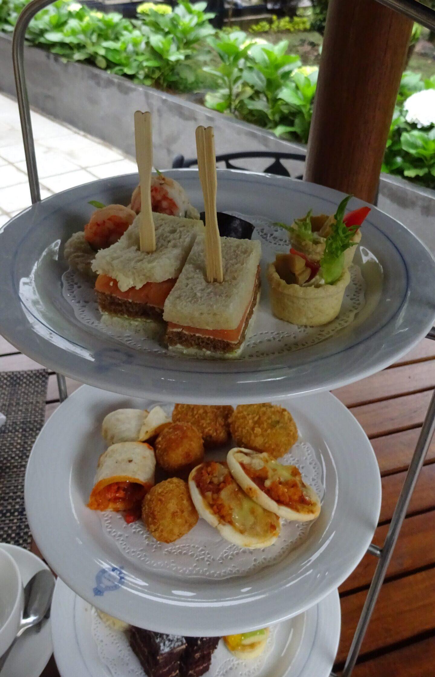 High tea 3 tiered stand with sandwiches and cake at The Grand Hotel, Nuwara Eliya, Sri Lanka