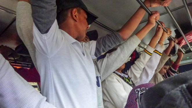 passengers standing on a busy bus in Sri Lanka