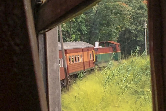 a view from the window of a train as it takes a bend in Sri Lanka