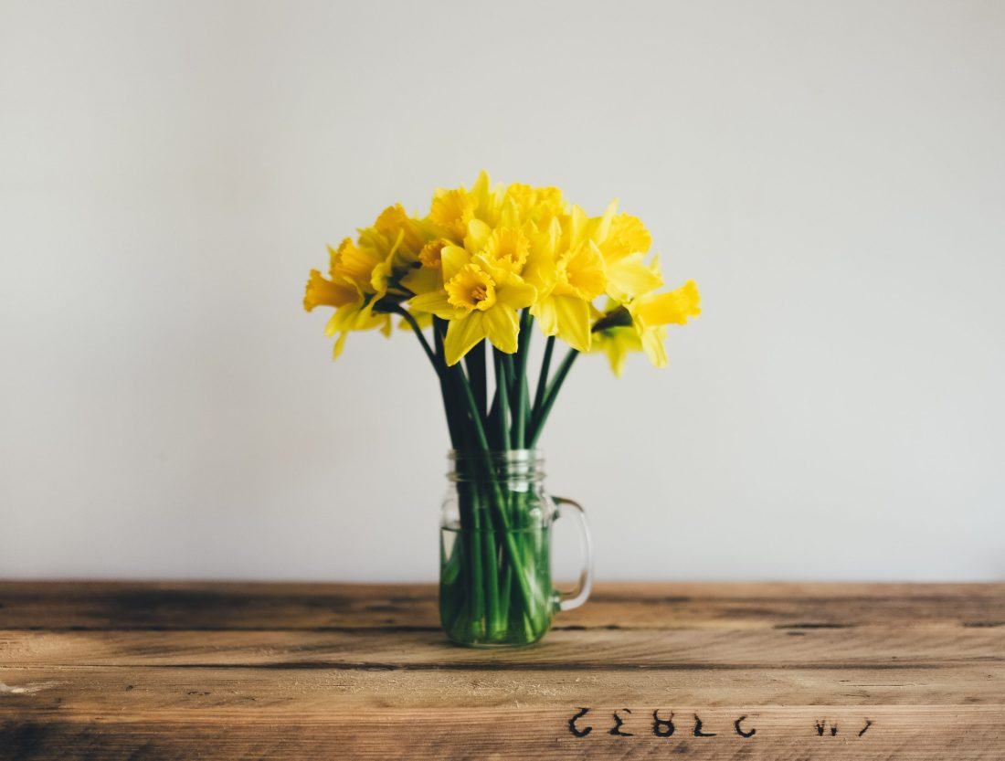 yellow petal flowers in clear glass vase