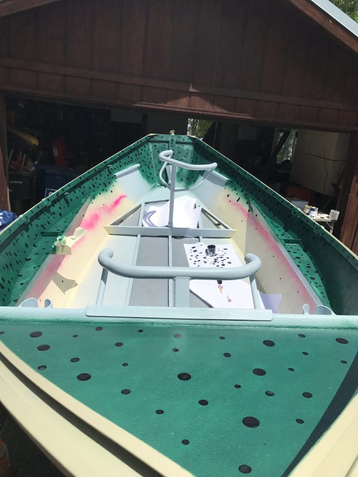The inside of the boat with the rainbow trout pattern before reinstalling the floors.
