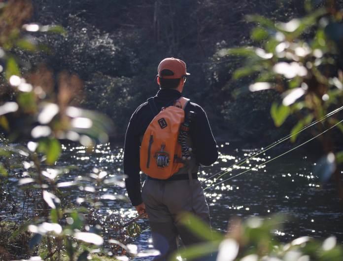 Angler standing with Fishpond sling