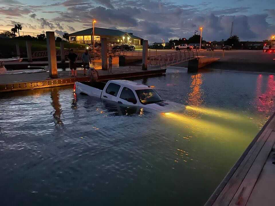 Truck backing into water