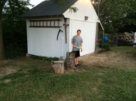 Jalen in front of D. Wood Shed