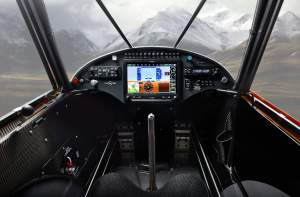carbon cub cockpit with mountains in the distance