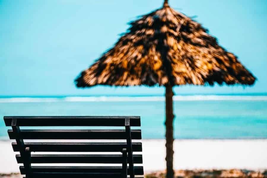 Beach lounge chair and umbrella on beach in Bali | Bali Beach Club