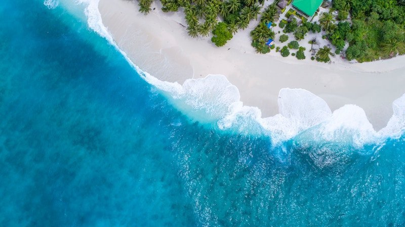 Aerial shot of beach and ocean in Fiji