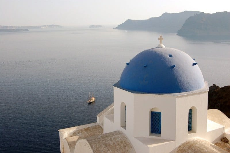 Blue dome overlooking the ocean in Santorini, Greece