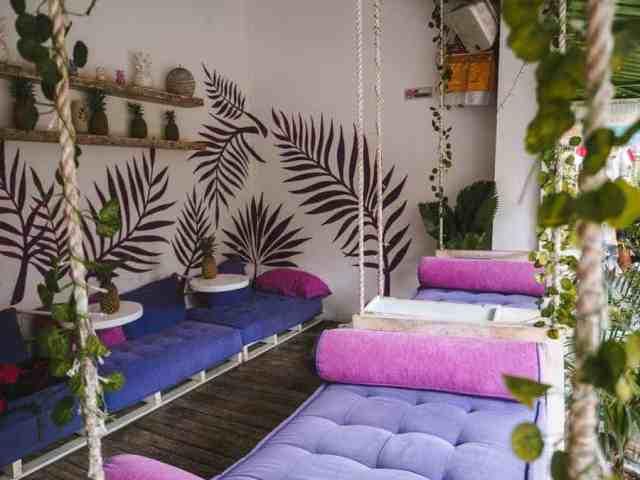 Purple cushions swings at Acai Queen in Ubud, Bali