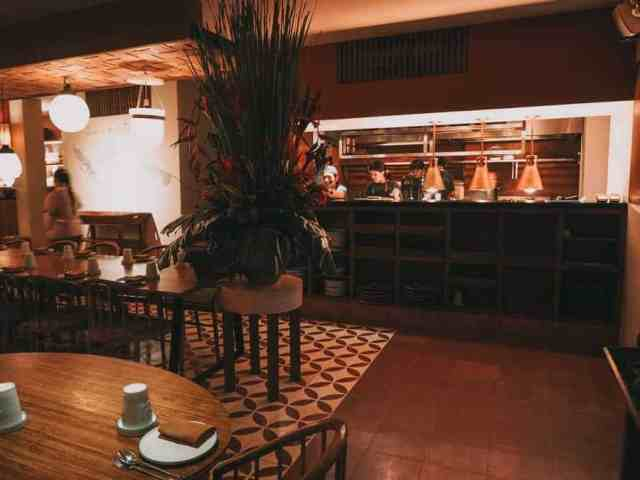 Looking towards the open plan kitchen at Nusantara Restaurant in Ubud, Bali