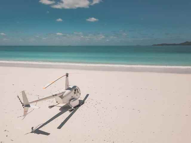 Hamilton Island Travel Guide | Visit the beautiful Whitsunday Islands and take scenic flight over the Great Barrier Reef. This guide features all the best things to do on Hamilton Island | Fly Stay Luxe