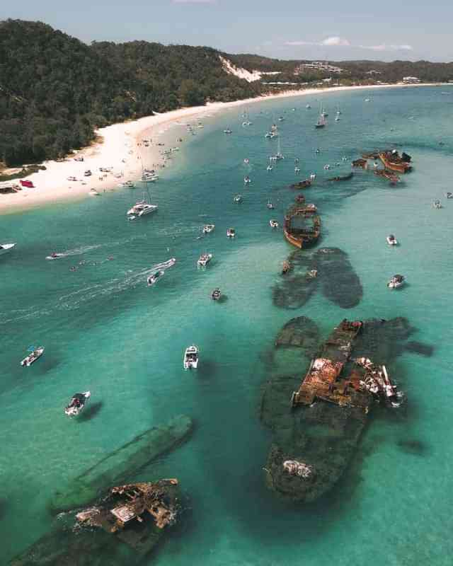 The Tangalooma shipwrecks have gone viral in Instagram. Want to know how to visit this marine wonderland. It's possible to visit Moreton Island in a day trips from Brisbane, Australia, or perhaps you might be interested in camping in the bays around Tangalooma Island Resort. #island #Tangalooma #moretonisland #brisbane #australia