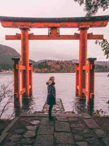Orange torii gate overlooking lake Ashinoko in Hakone