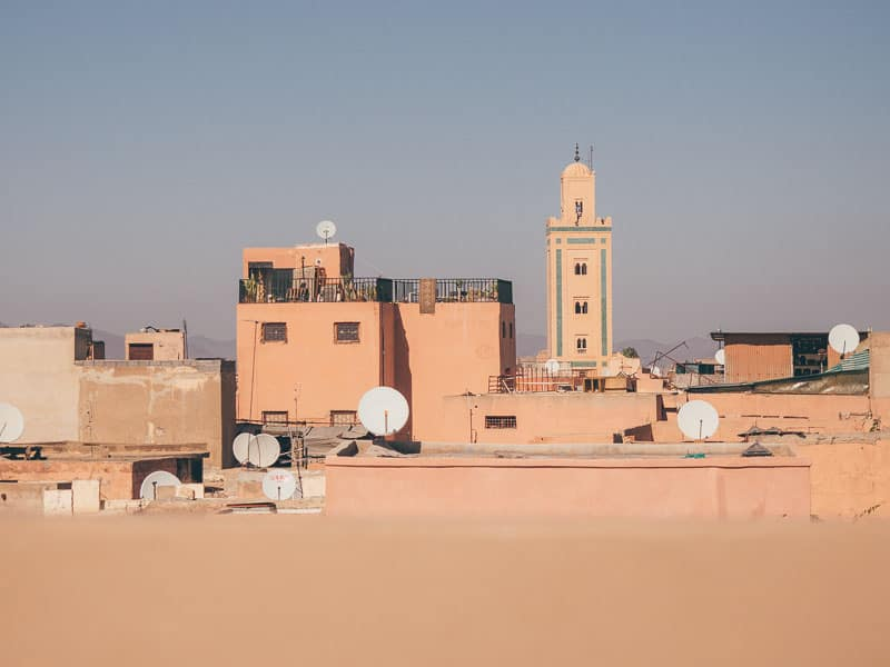 Blue skies and views over the pink Medina rooftops in Marrakech, Morocco.