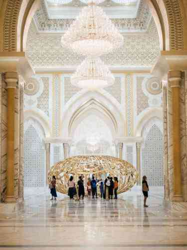 A gold monument and crystal chandeliers at the Abu Dhabi Presidential Palace, Al Watan Wing.