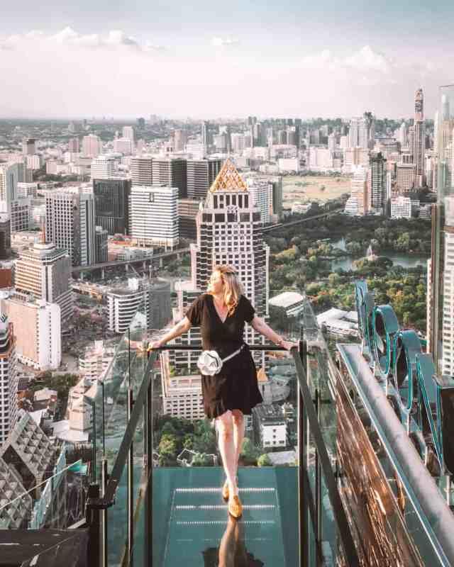 Girl soaking up the views over Bangkok from Moon Bar at the Banyan Tree Hotel