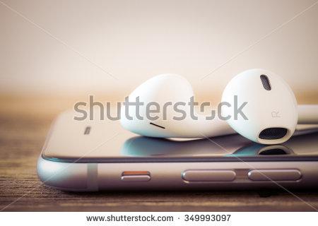 stock-photo-closeup-modern-headphone-on-phone-media-portable-349993097