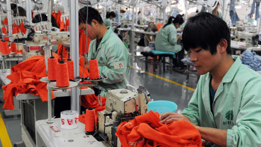 Workers sewing in a clothing factory in Bozhou, China.