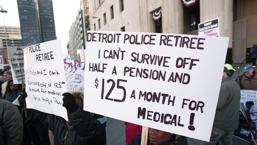 People, mostly union and retired city workers, protest in front of the U.S. Courthouse where Detroit's bankruptcy eligibility trial began this morning October 23, 2013 in Detroit, Michigan.