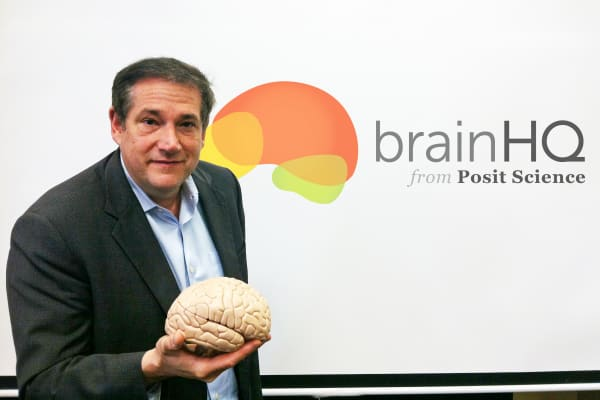 Jeff Zimman holding model of brain