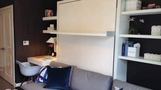 Studio model unit has Murphy-style bed wall unit to show how to maximize 372 square feet, furnishing unit not included in $280,00 price.