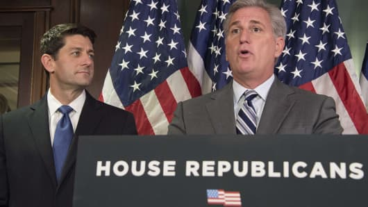 Speaker of the House Paul Ryan (L), R-Wisconsin, listens as House Majority Leader Kevin McCarthy, R-California, speaks to the press after a Republican Conference meeting in Washington, DC.