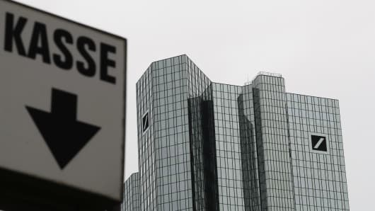 """A sign reading """"cash desk"""" is pictured next to the Deutsche Bank headquarters in Frankfurt, Germany, September 30, 2016."""