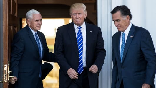 President-elect Donald Trump, Vice President-elect Mike Pence and Mitt Romney walk out at the clubhouse at Trump National Golf Club Bedminster in Bedminster Township, N.J. on Saturday, Nov. 19, 2016.