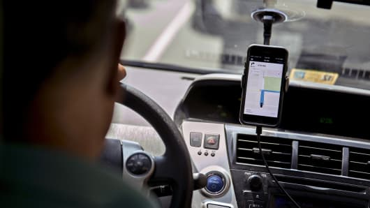 The Uber application on a smartphone during an Uber ride in Washington, D.C.