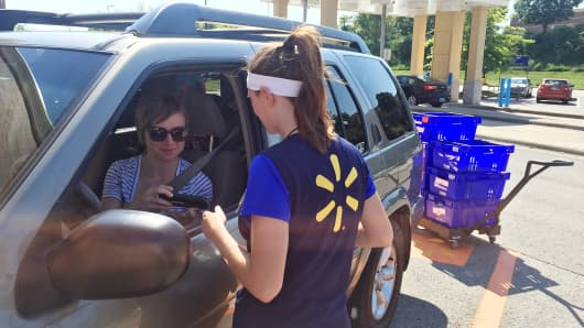 Ashley Green, 31, talks to a Walmart personal shopper as she retrieves her online grocery pickup order at the chain's Franklin, Tenn., location.