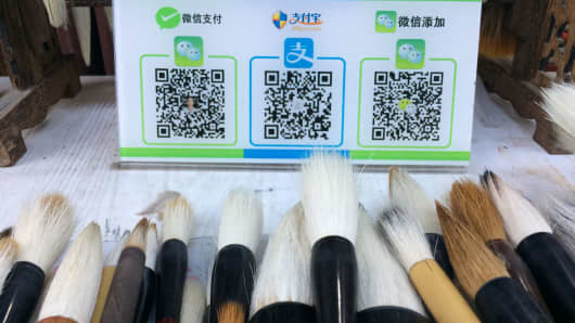 Customers can buy traditional Chinese calligraphy brushes at this Xi'an, China, store using QR payment codes. From left to right: WeChat Pay, Alipay and the QR code for the store's WeChat account.