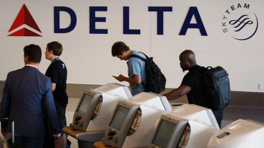 Delta Air Lines Inc. signage is displayed as a traveler uses self check-in kiosk in Delta Air Lines Inc.  Delta launches automatic check-in on its mobile app 104769731 GettyImages 485143514