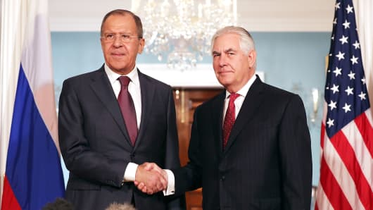 Russian Foreign Minister Sergey Lavrov (L) and U.S. Secretary of State Rex Tillerson shake hands in the Treaty Room before heading into meetings at the State Department May 10, 2017 in Washington, DC.  Moscow readies lawsuits over seized property 104770506 Lavrov Tillerson