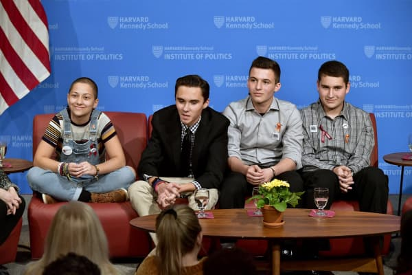 Survivors of Stoneman Douglas High School shooting (L-R) Emma Gonzalez, David Hogg, Cameron Kasky and Alex Wind speak at a panel discussion titled '#NEVERAGAIN: How Parkland Students are Changing the Conversation on Guns' moderated by Meighan Stone at Harvard University on March 20, 2018 .