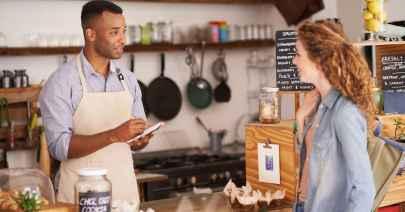 girl ordering at a bake shop