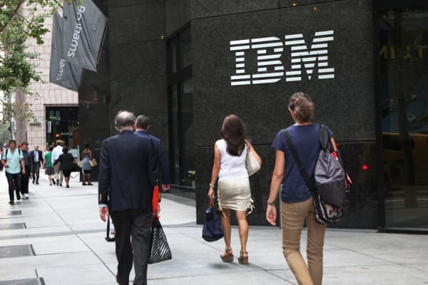 Pedestrians walk in front of the IBM building in New York.