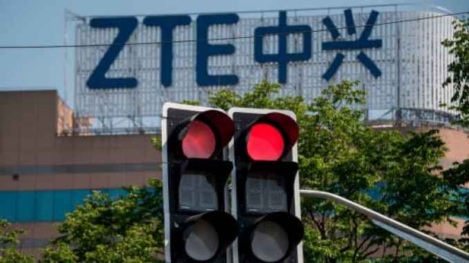 The ZTE logo is seen on an office building in Shanghai on May 3, 2018.