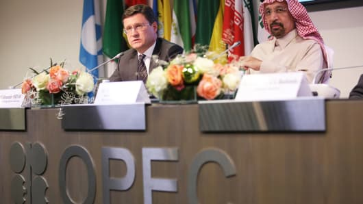 Alexander Novak, Russia's energy minister, left, speaks as Khalid Al-Falih, Saudi Arabia's energy and industry minister, listens during a news conference following the 173rd Organization of Petroleum Exporting Countries (OPEC) meeting in Vienna, Austria, on Thursday, Nov. 30, 2017.
