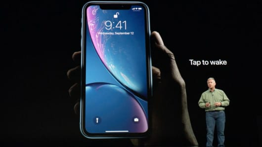 Philip W. Schiller, Senior Vice President, Worldwide Marketing of Apple, speaks about the the new Apple iPhone XR at an Apple Inc product launch event at the Steve Jobs Theater in Cupertino, California, September 12, 2018.