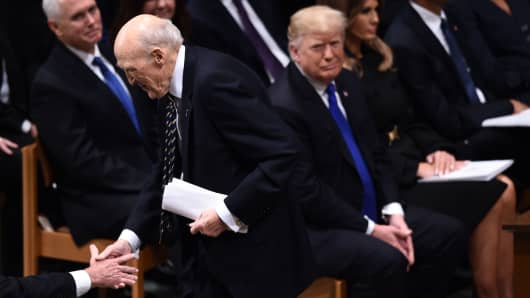 Former US Sen. Alan Simpson shakes hands after speaking during the state funeral of former US President George H.W. Bush at the Washington National Cathedral in Washington,DC on December 5, 2018.