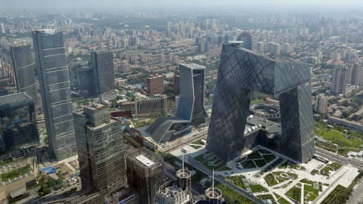 A general view shows the headquarter of China Central Television amid the Beijing skyline at central business district on August 3, 2013 in Beijing, China.