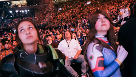 Spectators and fans react during the Activision Blizzard Overwatch League Grand Finals in New York on July 27, 2018.