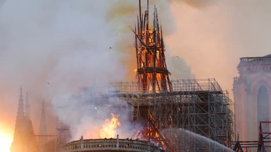 Smoke and flames rise during a fire at the landmark Notre Dame Cathedral in central Paris on April 15, 2019, potentially involving renovation works being carried out at the site, the fire service said.