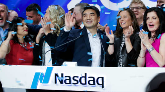 Confetti falls as Zoom founder Eric Yuan rings the Nasdaq opening bell on April 18, 2019 in New York City.