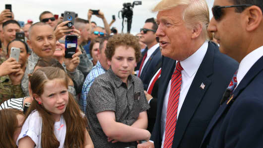 President Donald Trump greets members of the military and their families after stepping off Air Force One at Offutt Air Force Base, Nebraska on June 11, 2019.